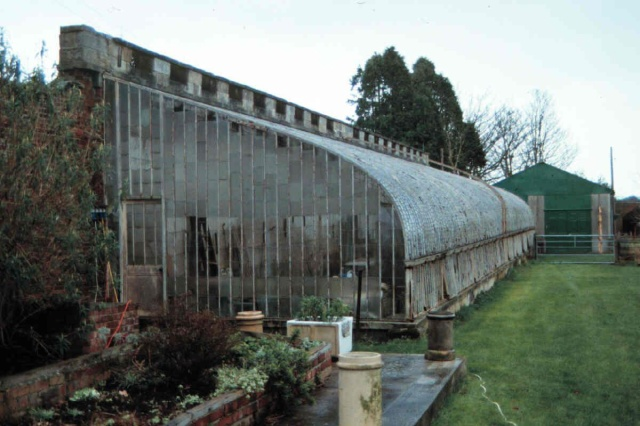 Unoccupied greenhouse of circa 1830 that incorporates an C18 garden wall. In very bad condition. English Heritage offered a grant in August 2011 to allow a repair scheme to be drawn up. Funding to allow repairs to be undertaken is being explored. http://risk.english-heritage.org.uk/register.aspx?id=46382&rt=1&pn=2&st=a&ua=Northumberland+(UA)&ctype=all&crit=