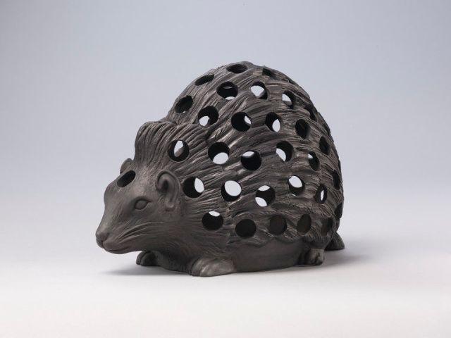 Bulb pot of black basalt, in the form of a crouching hedgehog, c.1820 V&A