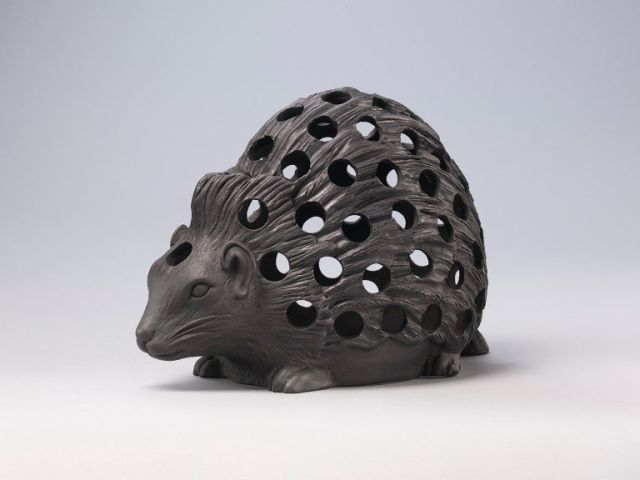 Bulb pot of black basalt, in the form of a crouching hedgehog, c.1820 V&A