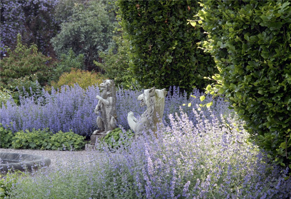 Heraldic beasts around the stone pond in the walled garden at Arley Hall Country Life Picture Library