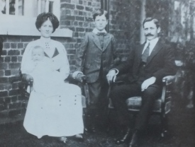 Percy as a baby, with his parents and elder brother outside the head gardener's house at Horwood