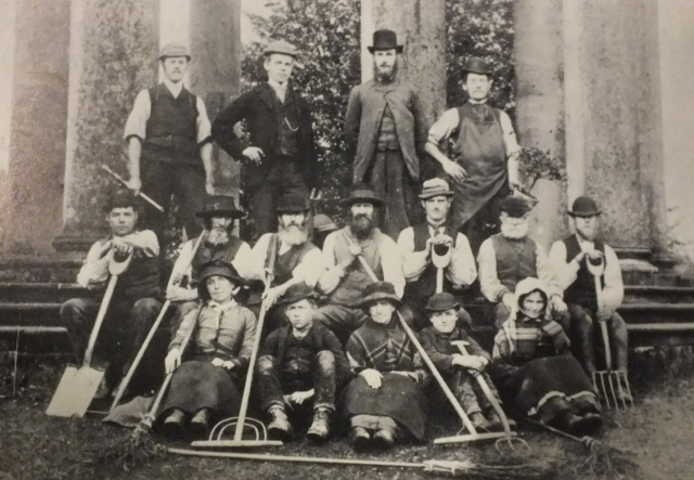 Michael Rochford with his garden staff, in front if the Rotunda in Duncombe Park from Mea Allan, Tom's Weeds, 1970