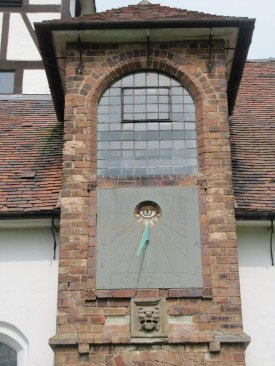 The church porch, sundial and lion's head at Benthall ©  oldchippy, panoramio.com