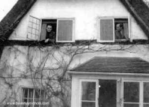 Beverly Nicholas [r] and his partner Cyril Butcher at the windows of the house, early 1930s http://www.beverleynichols.com