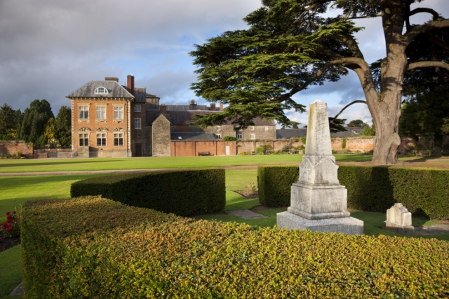 The south west front of Tredegar House, Newport, South Wales, viewed from the Cedar Garden. The house is a fine example of a late seventeenth century mansion. The stone obelisk within the hedge was erected to the memory of `Sir Briggs', the horse that carried Godfrey Morgan, at the famous Charge of the Light Brigade in 1854.