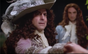 Stanley Tucci as the Duc of Orleans, Louis's brothrScreenshot from the official trailer https://www.youtube.com/watch?v=UOmEoP9PCYg