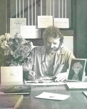 Harry in his office, witha photo of his mother, from My LIfe with Roses