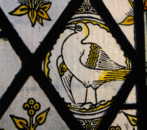 A stylised Peruvian booby bird - one source of guano - froma window at Tyntesfield. [Lesley Kinsley, 2013 from http://animalhistorymuseum.org]