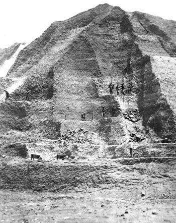 "Workers in the 1860s excavate a ""mountain"" of guano more than 60 feet tall. Photograph © Smithsonian Institution"