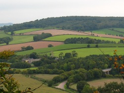 A view down from the hilltop at Killerton, looking across the M5. © Copyright Stephen Craven, 2010, and licensed for reuse under this Creative Commons Licence
