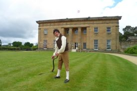 The Historic Gardener tending the lawn at Belsay Hall
