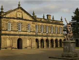 The forecourt stable wing at Seaton Delaval Hall with lead figures of David and Goliath in the foreground. Sim Used CL 07/04/2010
