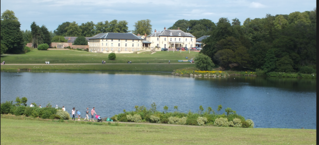 Hardwick Park Hotel with the Grand Terrace in front, from the south side of the lake David Marsh, July 2015