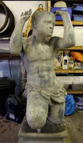 the statue of the blackmail stripped back to its lead base during restoration