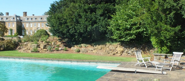 The rockery can be seen behind the swimming pool
