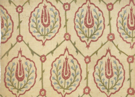 Part of a hanging (or cover), linen embroidered with silk in surface darning on the diagonal. The ground is divided into hexagonal compartments by a thin green stem with small leaves. There is a red flowerhead where the stems intersect. Each compartment contains a slightly lobed red medallion with a red tulip and two sprays of blue hyacinths inside. Turkey (made) Date: 1540-1699 (made) V&A