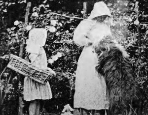 Marion with her younger daughter Lesley and their dog Bouncer in the garden at Steephill. Photo courtesy of Dudley Graeme